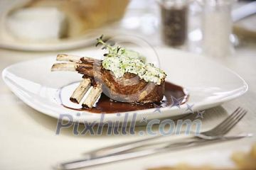 Portion of lamb carr� in restaurant