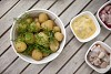 Boiled potatoes with dill and herring on table outside