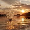 Water splash at sunset in lake