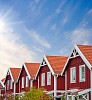 Red wooden houses on a sunny summer day