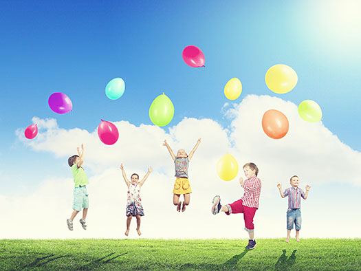 Group of happy children playing with colorful balloons